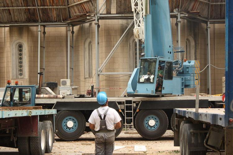 Worker operating crane