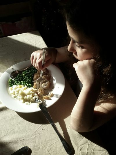 Mealtime Food People Child Eating Light And Shadow Ligth Fish Green Peas Table