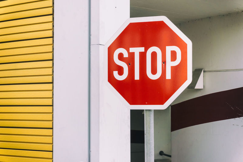 Stop sign at car park Architecture Berlin Built Structure Car Park Close-up Color Image Communication Day Germany 🇩🇪 Deutschland Guidance Horizontal No People Outdoors Red Stop Sign Text Yellow