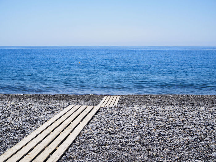 Sougia beach on the south side of Crete Beach Blue Clear Sky Holiday Horizon Over Water Minimalism No People Pebble Beach Sea Summer Tranquil Scene Tranquility Vacations Water
