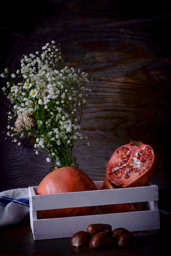 Autumn Fruits, Pomegranate and Chestnuts Chestnuts Close-up Flower Flowering Plant Food Food And Drink Freshness Fruit Healthy Eating Indoors  Meat Nature No People Plant Pomegranate Pork Small Group Of Objects Still Life Studio Shot Table Vegetable Wellbeing Wood - Material