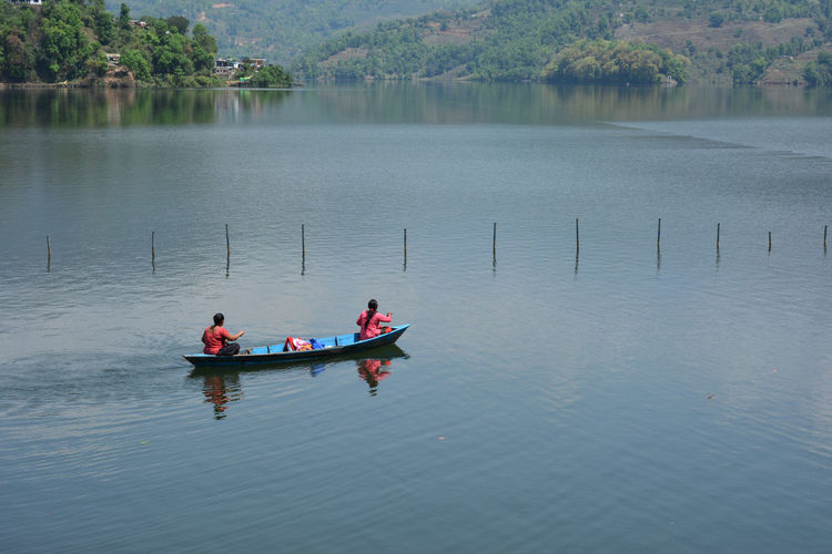 High Angle View Of Women In Boat On Lake