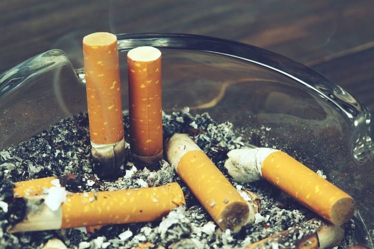 Close-up of cigarette smoking on table