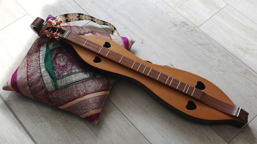 High angle view of guitar on table