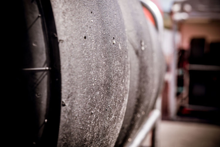 Set of slick car racing tires close up In A Row Set Tires Alcohol Close-up Equipment Factory Focus On Foreground Industry No People Pattern Racing Car Racing Tires Selective Focus Slick Tires Wheel