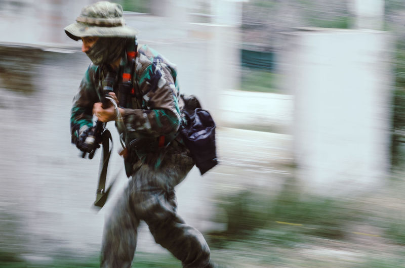 Blurred motion soldier Blurred Motion Motion One Person Sport Holding Real People Men Day Running Gun Clothing Weapon Speed on the move Military Three Quarter Length Transportation Outdoors Lifestyles Government Machine Gun Aggression  Airsoft