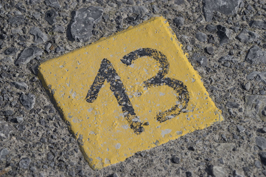 Number 13 in stone 13 Luck Lucky Thirteen Close-up Day No People Number Number 13 Outdoors Road Unlucky Unluckyday Yellow Yellow Color Paint The Town Yellow