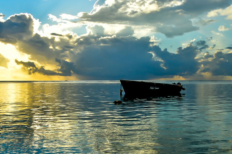 Rowboat Horizon Over Water Horizon Outdoors No People Idyllic Nature Sunset Tranquil Scene Reflection Tranquility Mode Of Transportation Transportation Scenics - Nature Nautical Vessel Beauty In Nature Sea Water Sky Waterfront Cloud - Sky Mauritius