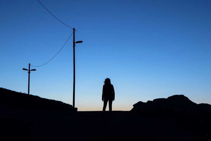 """"""" When the sky becomes blue at night """". Silhouette Clear Sky Outdoors Nature One Person Getting Inspired Eye4photography  Shootermag EyeEm Best Shots Light And Shadow Landscape My Year My View"""