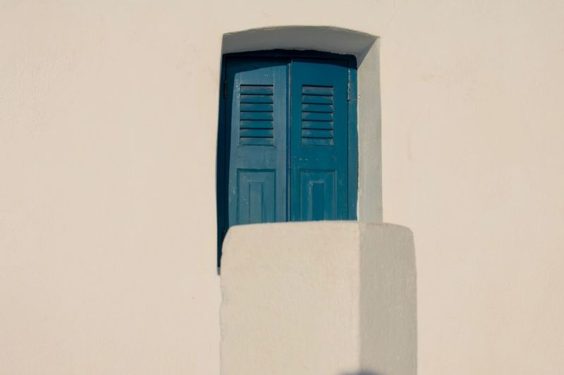Window Close-up Summer EyEmNewHere Minimalism Blue Window EyeEm Selects Built Structure Architecture Building Exterior Window Wall - Building Feature Building No People Day Closed White Color Outdoors Door Copy Space Entrance Sunlight House Protection Residential District Blue Capture Tomorrow