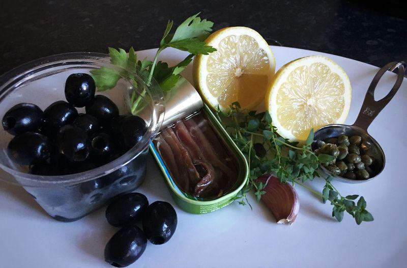 Black olives and lemons on table