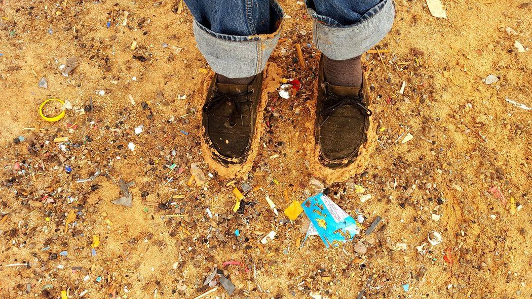Earth Dirt Mud Blue Jeans Long Socks Debre Trash Slick Desert Rain Sahara Desert Trashed Explored In Deep Refugees Missions Trip Soil Soiled Mobilephotography Mobile Photography