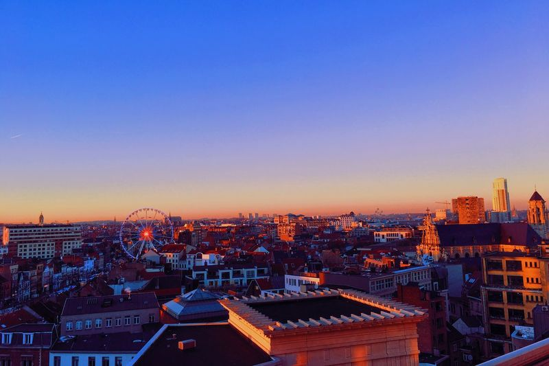 High Angle View Of City At Dusk