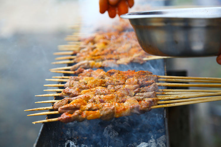 Food Food And Drink Heat - Temperature Preparation  Freshness Burning Meat Skewer Close-up Preparing Food Human Hand Smoke - Physical Structure Barbecue Day Asian Food Real People Selective Focus