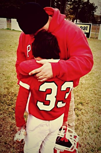 My husband & son, crying after a very tough loss in the State Playoffs. This pic still chokes me up when I look at it.