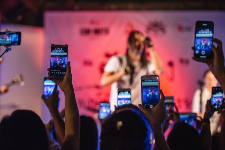 Rear View Of People Photographing At Music Concert