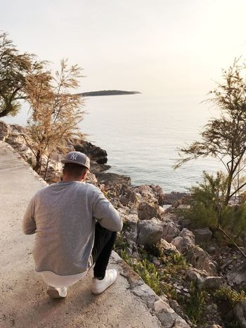 Rear View One Man Only One Person Beach People Sea Sitting Day Outdoors Water Nature Horizon Over Water Sky Full Length Me Taking Photos Men Croatia Only Men Adult Adults Only Primošten Adriatic Sea