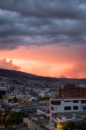 Sunset during summer with stormy clouds in Quito, Ecuador. Latin America Architecture Building Building Exterior Built Structure City Cityscape Cloud - Sky Dramatic Sky High Angle View Nature No People Orange Color Outdoors Overcast Residential Building Residential District Romantic Sky Settlement Sky Summer Sunset Town TOWNSCAPE Urban Skyline Capture Tomorrow
