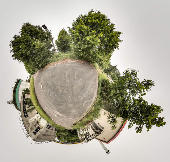 Digital composite image of trees and building against sky