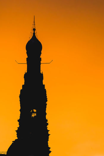 Silhouette statue of a building at sunset