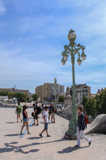 Architecture Building Exterior Built Structure City City Life Clear Sky Dusk Enjoyment Holiday Incidental People Low Angle View Marseille Outdoors Recreational Pursuit Sky Statue Street Light Togetherness Tourist Travel Travel Destinations Vacation Vacations Weekend Activities