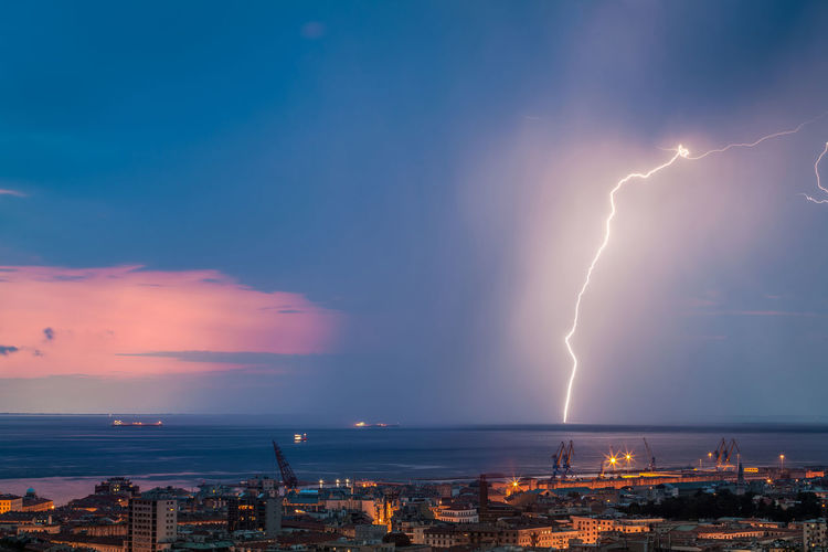 Lightning Cloud - Sky Power In Nature Architecture Building Exterior Sky City Built Structure Power Thunderstorm Illuminated Storm Night Beauty In Nature Cityscape Forked Lightning Nature No People Water Outdoors Ominous
