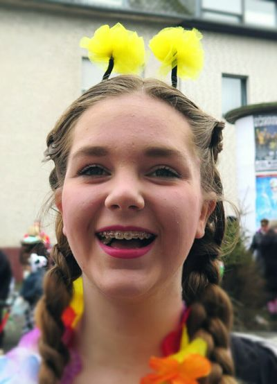 Portrait Of Smiling Teenage Girl Wearing Flowers During Carnival