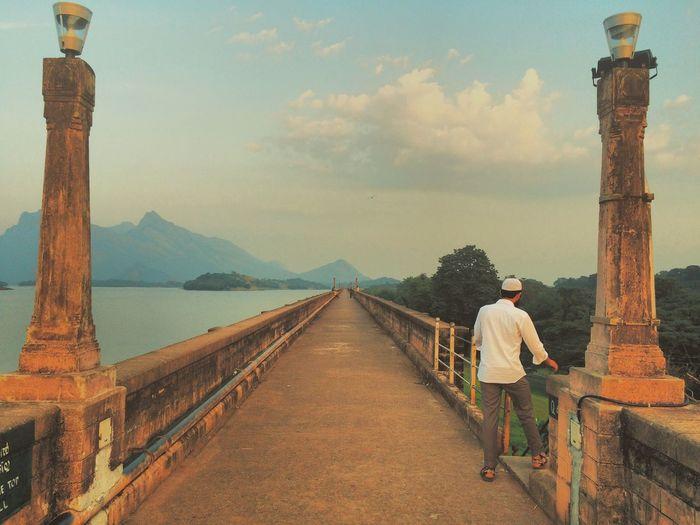 Tourist walking on sidewalk