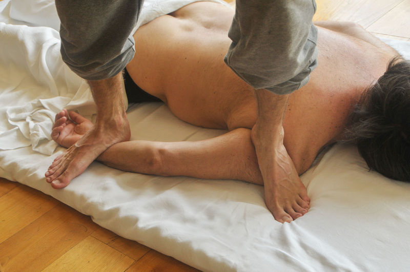 Low Section Of Therapist Massaging Man At Spa