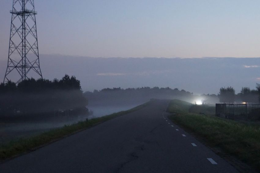 a foggy autumn morning along the river IJssel Autumn Carlights Clear Sky Dawn Diminishing Perspective Empty Road Field Foggy Illuminated Landscape Long Nature Non-urban Scene Outdoors Road Scenics Sky Solitude Sunrise - Dawn Tranquil Scene Tranquility Transportation Tree Vanishing Point