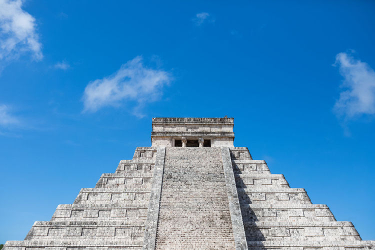 Low Angle View Of Chichen Itza Against Blue Sky