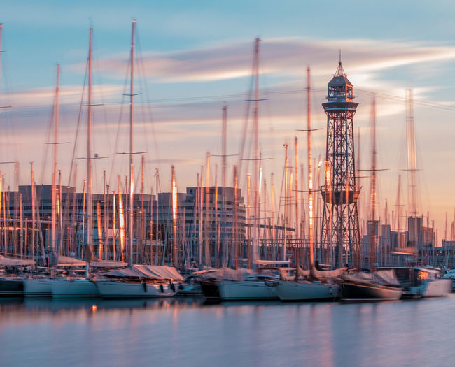 Architecture Building Exterior Built Structure Cloud - Sky Harbor Mast Mode Of Transportation Moored Nature Nautical Vessel No People Outdoors Sailboat Sea Sky Sunset Tower Transportation Water Waterfront Yacht