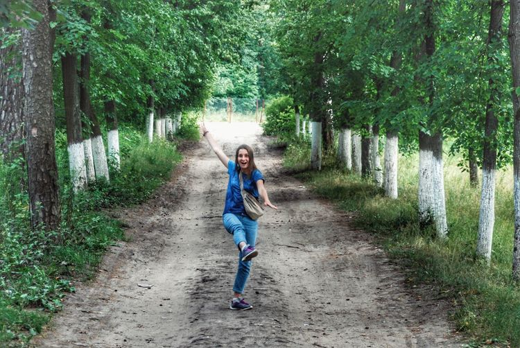 Full Length One Person Green Color Outdoors Day Tree The Way Forward People Nature Childhood Child Girls Real People Children Only Smiling Adult Beauty In Nature Young Adult Been There. Connected By Travel Done That. Lost In The Landscape EyeEmNewHere Discover Berlin