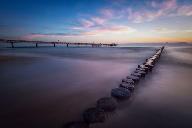 ;orning sky on Koserow beach Sky Water Sunset Scenics - Nature Sea Tranquility Tranquil Scene Cloud - Sky Beauty In Nature Nature No People Horizon Over Water Horizon Beach Idyllic Dusk In A Row Reflection Outdoors Post Wooden Post EyeEmNewHere Baltic Sea Wave Breaker Usedom