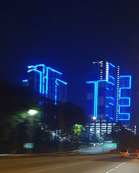 "night light building from highway"" Illuminated Neon City Blue Sky Lightning Office Building Skyscraper Urban Skyline Building Tower Cityscape Skyline First Eyeem Photo"