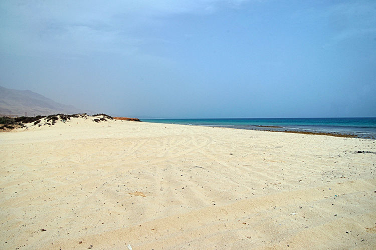 Beach Land Sea Water Sand Scenics - Nature Tranquility Beauty In Nature Sky Tranquil Scene Horizon Over Water Nature Horizon Day No People Non-urban Scene Idyllic Outdoors Remote