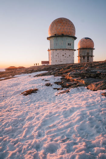 Architecture Building Exterior Built Structure Cold Temperature Day Dome Lighthouse Manteigas Nature No People Outdoors Sky Snow Sunset Water Tower - Storage Tank Winter