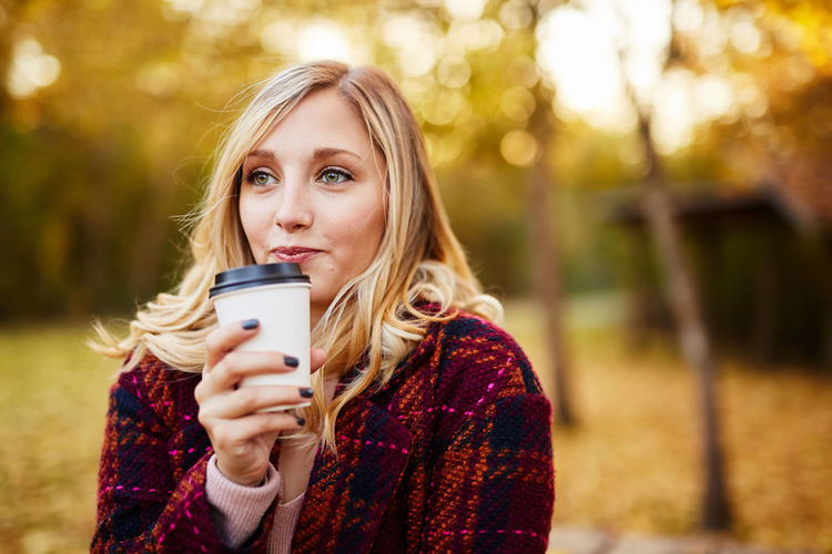 Autumn Blond Hair Communication Focus On Foreground Holding Leisure Activity Lifestyles Long Hair Mobile Phone Nature One Person Outdoors Park - Man Made Space Photography Themes Portable Information Device Portrait Real People Scarf Smart Phone Smiling Standing Technology Wireless Technology Young Adult Young Women