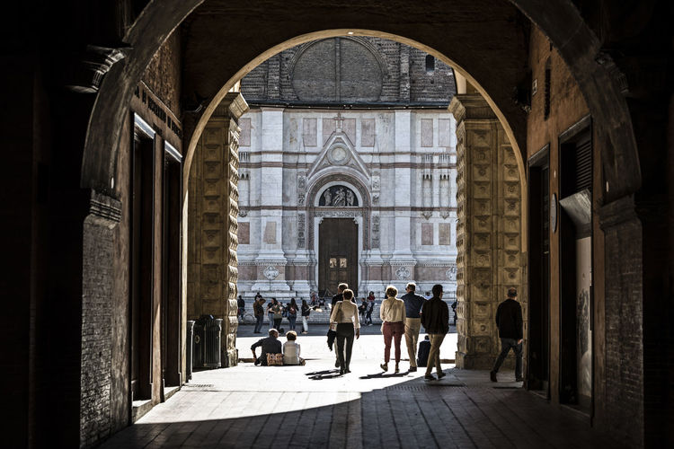 Piazza Maggiore Street Turists Arch Travel Destinations The Past Ancient Design Architecture Emilia Romagna Bologna, Italy Group Of People Built Structure Real People History Crowd Large Group Of People Place Of Worship Religion Walking Building Exterior Adult Belief Men Women
