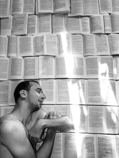 Books EyeEmNewHere Backgrounds Beard Black And White Book Facial Hair Flooring Headshot Home Interior Indoors  Leisure Activity Lifestyles Looking Looking Away Men One Person Portrait Real People Shirtless Sleeping Young Adult Young Men