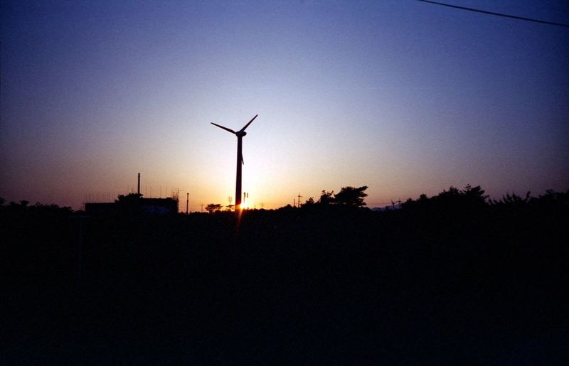 Sunrise Alternative Energy Fuel And Power Generation Renewable Energy Environmental Conservation Wind Turbine Sunset Wind Power Silhouette Windmill Dusk Sky No People Nature Rural Scene Electricity  Beauty In Nature Industrial Windmill Outdoors Day Lomography Fujireala