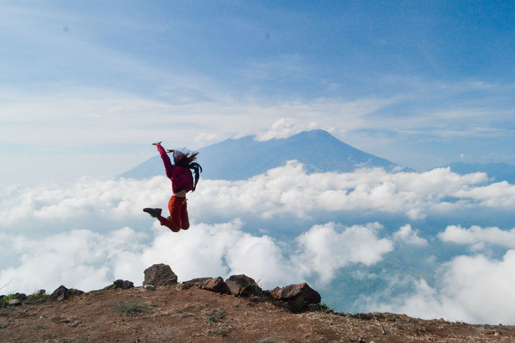 Mountain Sky Extreme Sports Mid-air Stunt Flying Cloud - Sky Nature One Person Day Motion Full Length Sport Exhilaration Air Vehicle Airplane Leisure Activity Adventure Jumping Skill  Springtime Decadence