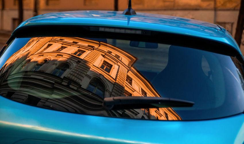 Close-up of car against blue sky