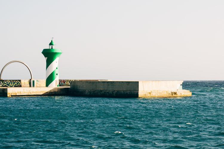 Lighthouse Over Sea