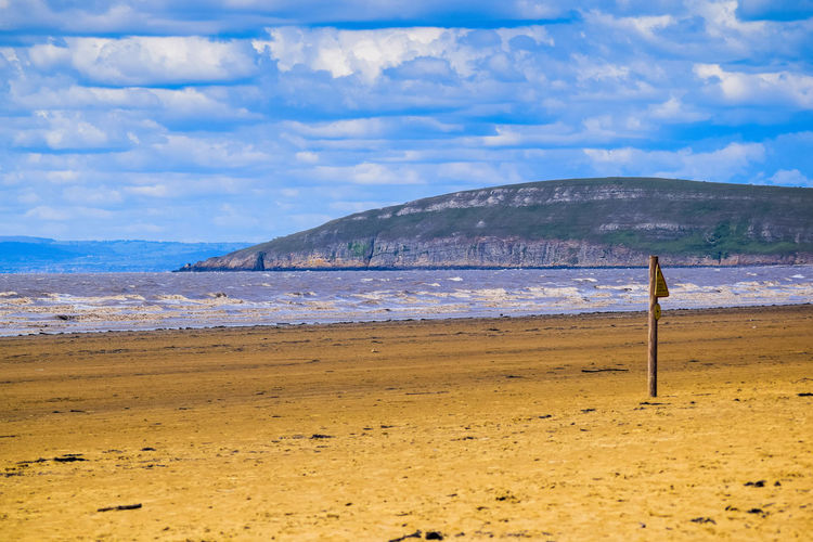 Sea Beach Land Water Sky Sand Nature Day Outdoors Beach Photography Horizon Over Water Leading Lines Space For Text Space For Copy Cloud - Sky Scenics - Nature Tranquil Scene Beauty In Nature Tranquility Non-urban Scene Mountain No People Idyllic Remote Brean Down Flag Red Flag