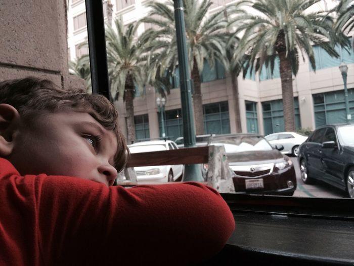 Thoughtful Boy Leaning On Window Sill