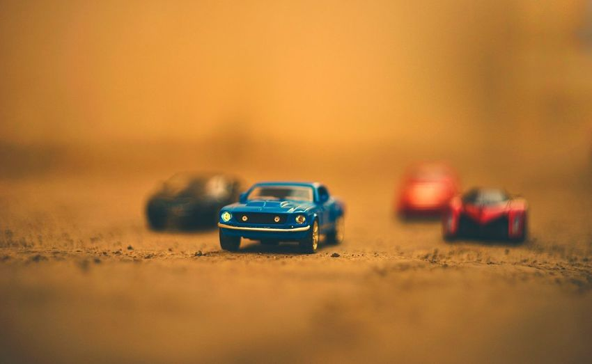 Close-up of toy cars on road