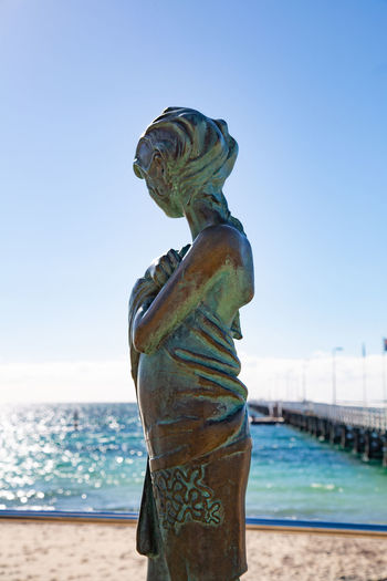 Water Sky Sea Art And Craft Representation Sculpture Human Representation Nature No People Land Creativity Statue Day Blue Clear Sky Beach Close-up Male Likeness Horizon Over Water Outdoors
