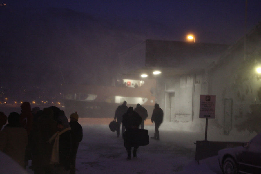 City Life Dark Far North Harbour Illuminated Men Night Norway Polar Circle Snow Snowing Tromsø Walking Winter