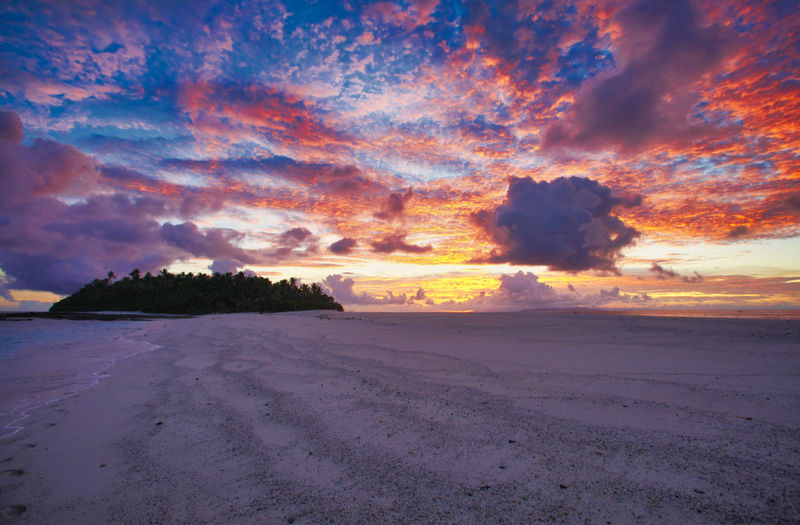 Paradise Beach at the Fiji Islands Fiji Fiji Islands Island Tropic Fiji Sunset Sunrise Sky Beauty In Nature Cloud - Sky Scenics - Nature Tranquil Scene Tranquility Land Idyllic No People Nature Outdoors Environment Beach Orange Color Sand Water Landscape Sea Non-urban Scene